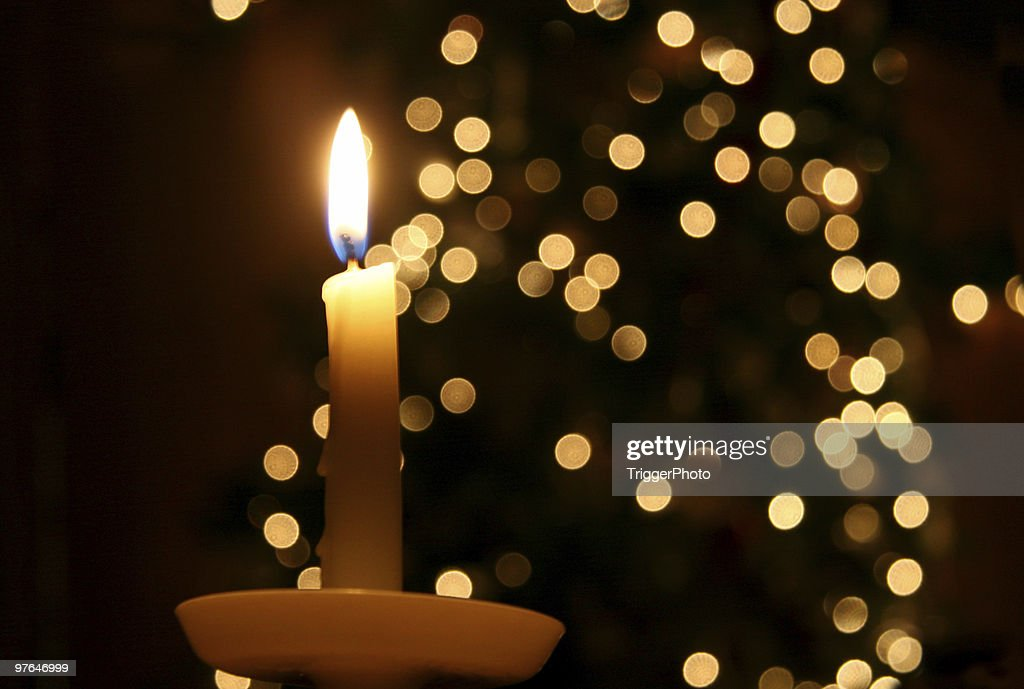 Candle light and a Christmas tree : Stock Photo