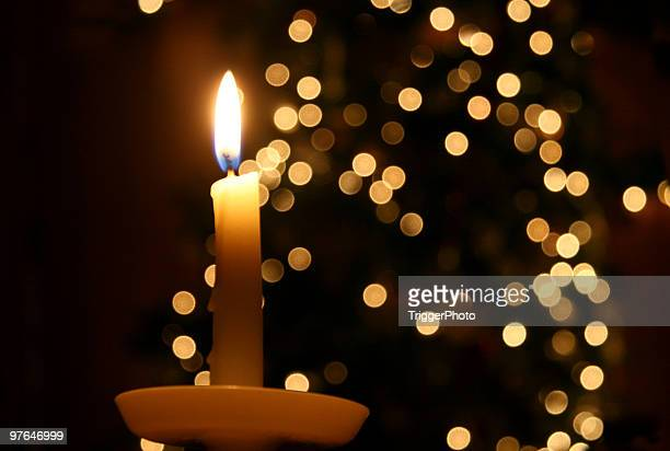 candle light and a christmas tree - candle stock pictures, royalty-free photos & images