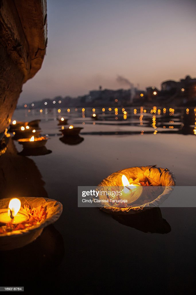 Candle light offering : Stock Photo