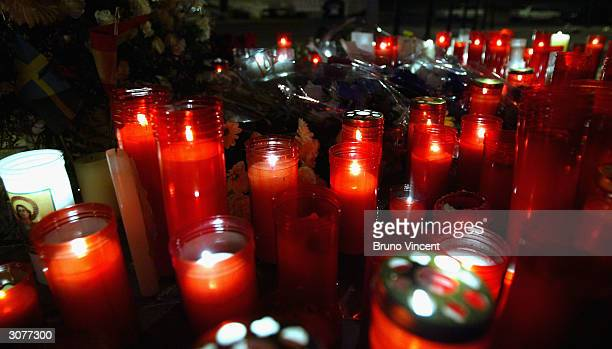 A candle light tribute is seen at Santa Eugenia train station where a bomb detonated during the morning rush hour March 11 2004 in Madrid Spain...
