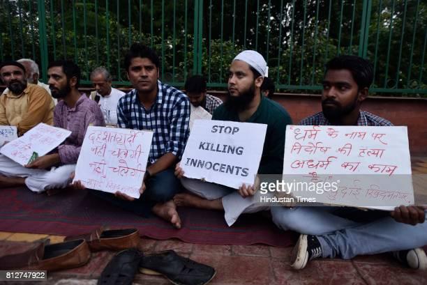 A candle light vigil and solidarity meet was organised by Khudai Khidmatgar outside Jamia Milia University to condemn the killings of Amarnath Yatra...