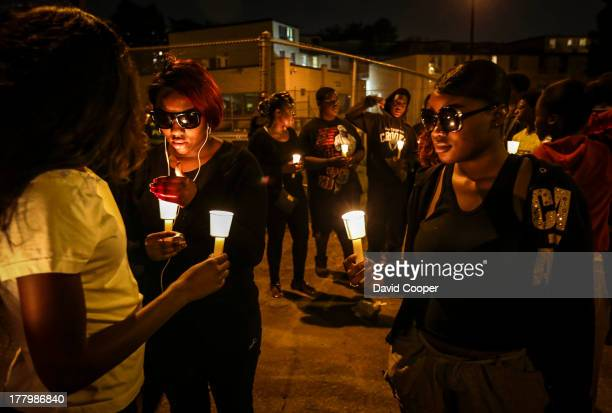 Candle light vigil held shortly after 9pm in honor of people killed by gun violence in the Firgrove social housing community south of Jane and Finch