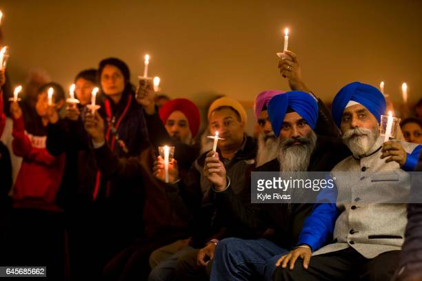 A candle light vigil is held at the end of the Prayer Vigil for the victims of the Austins Bar and Grill shooting on February 26 2017 at the Ball...