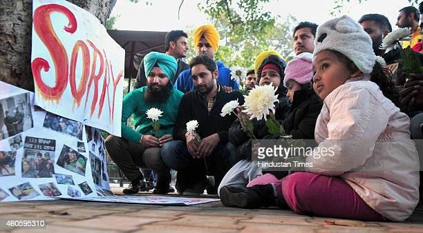 A candle light vigil was held by people representing different organizations outside Nizamuddin Dargah for the victims Taliban attack in Peshawar on...