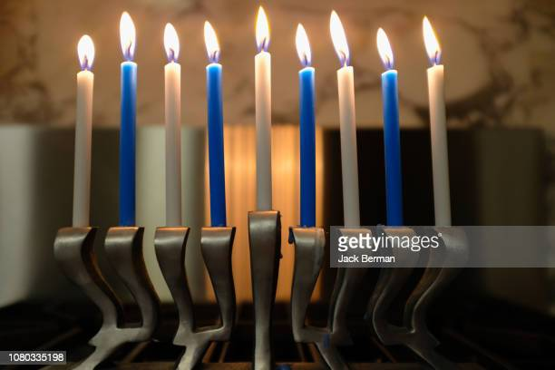 candle lights - menorah stock photos and pictures