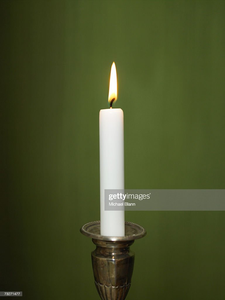 Candle lit in candle holder : Stock Photo