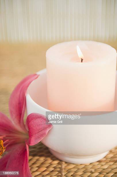 Candle next to lily