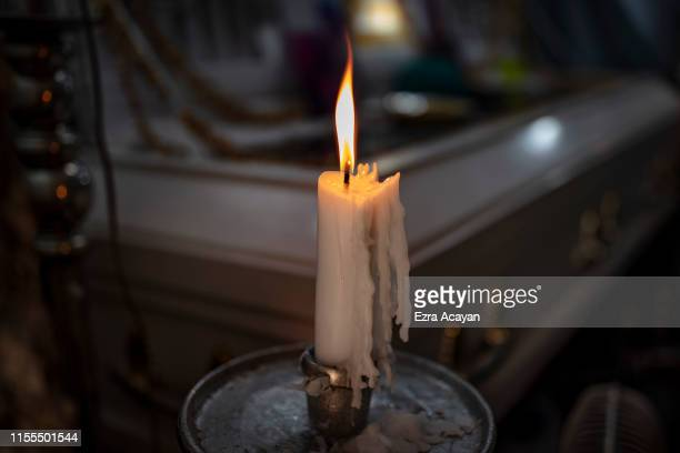 Candle next to the coffin of Jaybee Castor on July 13, 2019 in Caloocan, Metro Manila, Philippines. According to relatives, Castor was abducted and...