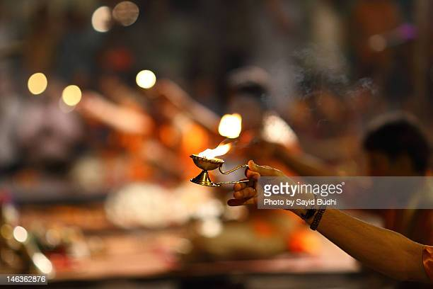 candle of aarti ceremony - ceremony stock pictures, royalty-free photos & images
