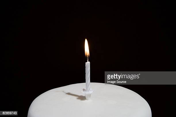 candle on a birthday cake - birthday candle stock pictures, royalty-free photos & images