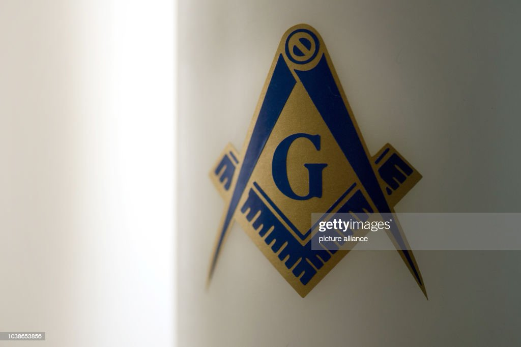 A Candle That Bears The Freemasonry Symbol Is Pictured In Temple Of Masonic Lodge
