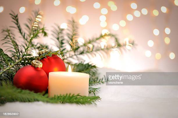 Candle with christmas balls and pine tree