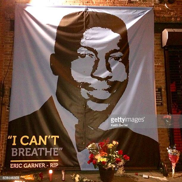 A candlelight and flower Tribute To Eric Gardner by Spike Lee outside of his 40 Acres A Mule FilmWorks Headquarters in Fort Greene Brooklyn NYC