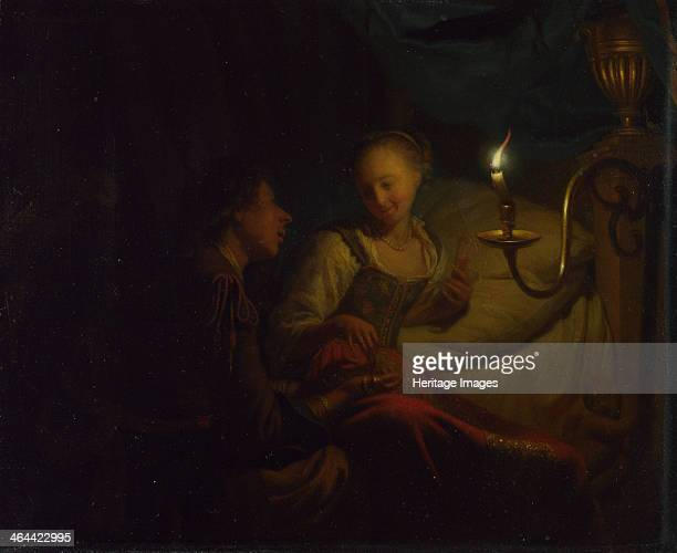 A Candlelight Scene A Man offering a Gold Chain and Coins to a Girl seated on a Bed ca 16651667 Found in the collection of the National Gallery London