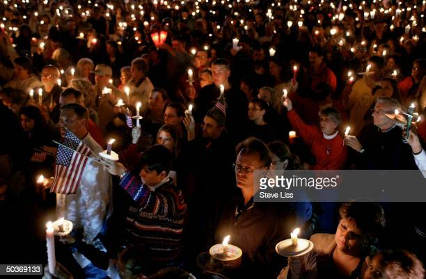 Candlelight vigil drawing over 1,000 people in the days after the devastating 9/11 terrorist attacks on New York City's World Trade Center & the...
