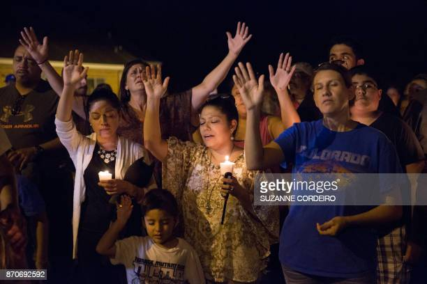 TOPSHOT A candlelight vigil is observed on November 5 following the mass shooting at the First Baptist Church in Sutherland Springs Texas that left...