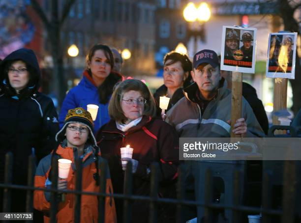 A candlelight vigil was held tonight in Central Square in East Boston for Boston firefighter Michael R Kennedy and Fire Lieutenant Edward J Walsh Jr...