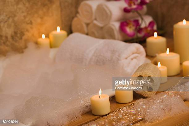 candlelit bubble bath - bubble bath stock pictures, royalty-free photos & images