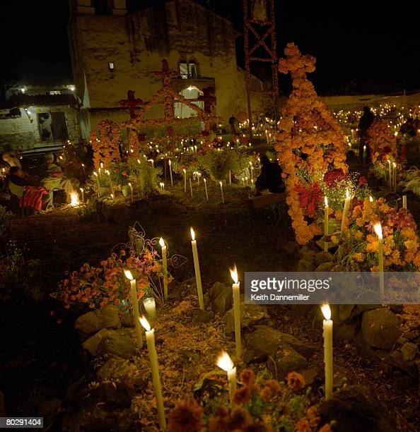 Candlelit cemetery during Day of the Dead ritual in Arocutin, Michoacan, Mexico.