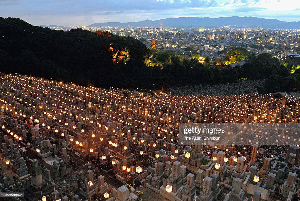 Candle-lit lanterns are placed during the 'Higashi Otani Mantoe' at Otani Sobyo Mausoleum on August 14, 2014 in Kyoto, Japan. The event started in 1961 by the Higashi Honganji Temple which owns the graveyard, so that people visit their ancestors' thumbs after sunset, avoiding summer heat in the daytime. Japan is in a holiday week of the 'Bon', or 'Obon', a Japanese custom and season to honor the spirits of ancestors in mid-August.
