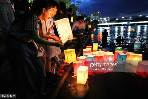 Candlelit paper lanterns are released on the Motoyasugawa River on the 72nd anniversary of the Abomb dropping of Hiroshima on August 6 2017 in...