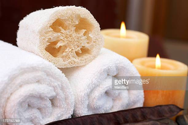 candle-lit towels and loofah - loofah stock photos and pictures