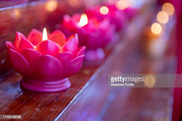 candles alight as part of a ceremony - ceremony stock pictures, royalty-free photos & images