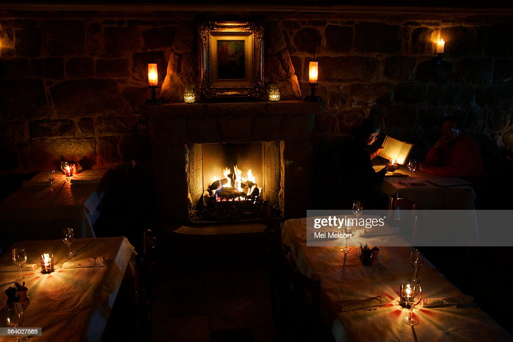 Candles and a fireplace make up the lighting inside the newly renovated Plow & Angel restaurant at San Ysidro Ranch in Santa Barbara