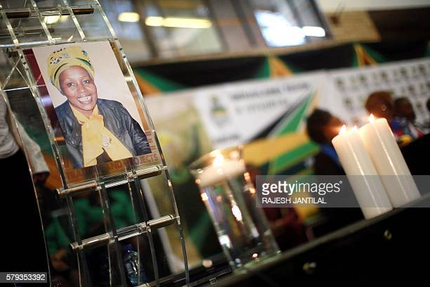 Candles and a portrait of late African National Congress ward candidate Khanyisile NgobeseSibisi are seen during her funeral ceremony in Ladysmith...