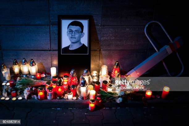 Candles and a portrait of Slovak investigative journalist Jan Kuciak are pictured in front of the Aktuality newsroom in Bratislava on February 26...