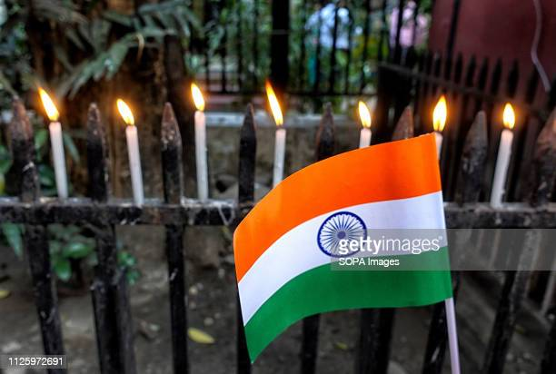 Candles and an Indian flag seen in front of the British Council UNICEF West Bengal Office with a demand to declare Pakistan as a Terrorist State and...
