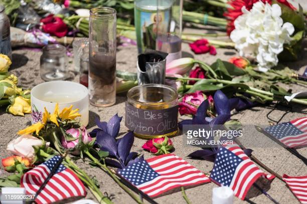 Candles and flowers a placed in front of Ned Peppers bar after the mass shooting over the weekend in Dayton, Ohio on August 5, 2019. - US President...