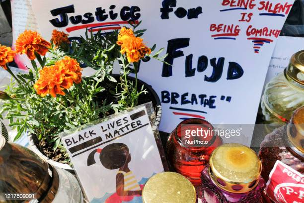 Candles and flowers are laid in front of the US Consulate General as a memorial event for George Floyd Krakow Poland on June 3 2020 George Floyd a...