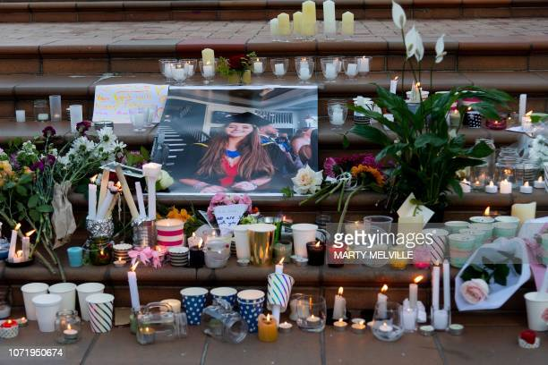 Candles and flowers are laid next to a photo of murdered British backpacker Grace Millane during the vigil for murdered British backpacker Grace...