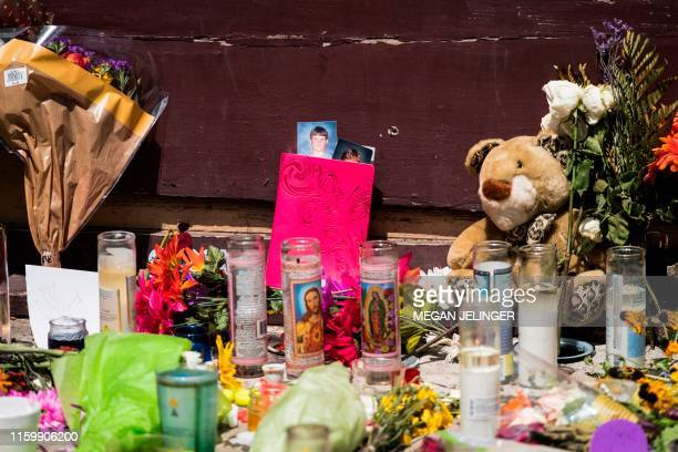 Candles and Flowers are placed at Ned Peppers after the mass shooting over the weeekend in Dayton Ohio on August 5 2019 US President Donald Trump...