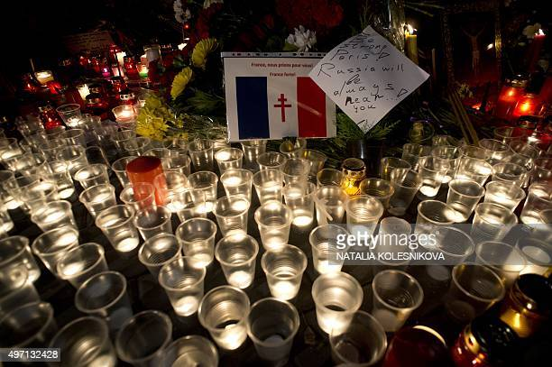 Candles and flowers are placed outside the French embassy in Moscow on November 14 a day after deadly attacks in Paris At least 128 people were...