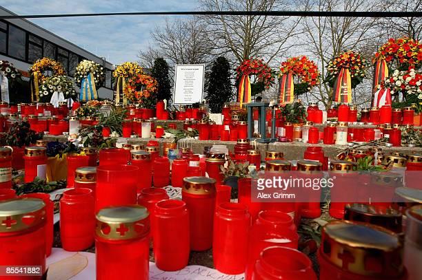 Candles and flowers are seen outside Albertville high school on March 21 2009 in Winnenden near Stuttgart Germany 17 year old Tim Kretschmer opened...
