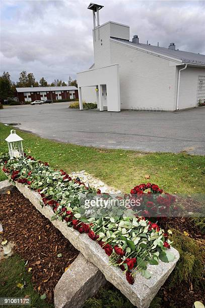 Candles and flowers are set up on the memorial next to the Kauhajoki vocational school in Kauhajoki, on September 23, 2009 for those killed in the...