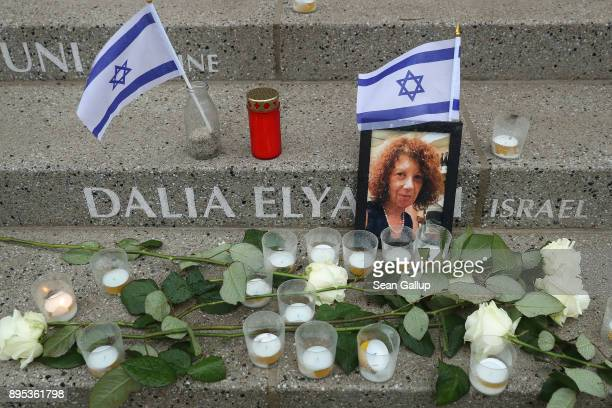 Candles and flowers lay at the inscription to Israeli victim Dalia Elyakim at a memorial to victims shortly after its inauguration at the site of the...
