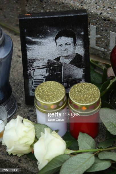 Candles and flowers lay at the inscription to Polish victim Lukasz Urban the truck driver killed by terrorist Anis Amri for his truck at a memorial...