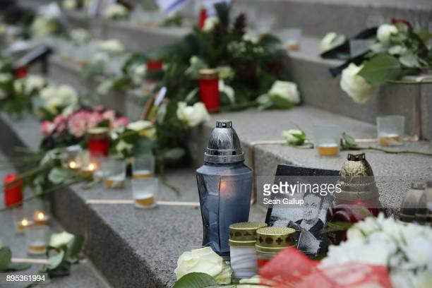 Candles and flowers lay at the inscription to Polish victim Lukasz Urban the truck driver killed by terrorist Anis Amri for his truck and other...