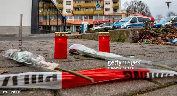 Candles and flowers lay in front of one of the bar target in a shooting in Kesselstadt near Frankfurt western Germany on February 20 2020 The suspect...