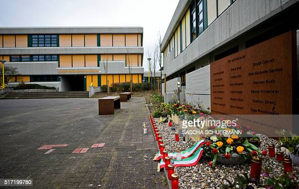 Candles and flowers lie in front of the Joseph Koenig Gymnasium at a memorial plaque for the victims of the Germanwings plane crash in the French...