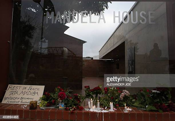 Candles and flowers set as tribute to late former South African president Nelson Mandela in front of his former house in Soweto on December 6 2013...