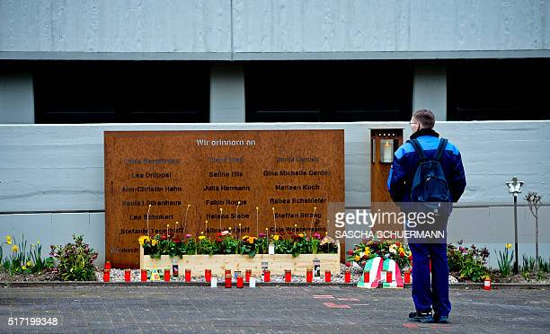 Candles and fresh flowers lie in front of the Joseph Koenig Gymnasium at a memorial plaque for the victims of the Germanwings plane crash in the...