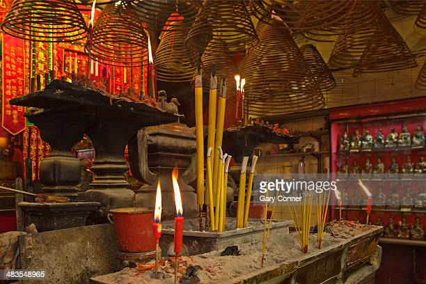 candles and incense burn at temple - incense coils stock photos and pictures
