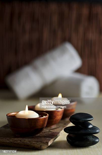 Candles and Massage Stones in a Zen Spa Background