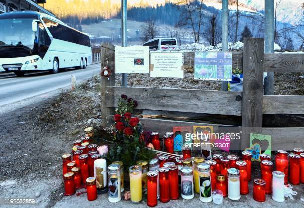 Candles and notes are pictured at a makeshift memorial on Via Aurina in Lutago South Tyrol on January 6 2020 at the location where a drunk driver...