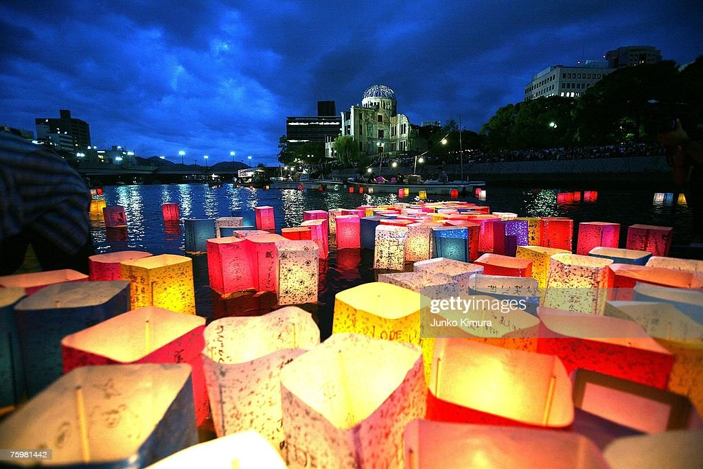 Candles and paper lanterns float on the Motoyasu River in front of the Atomic Bomb Dome at the Peace Memorial Park, in memory of the victims of the bomb on the 62nd anniversary of the Hiroshima bomb, on August 6, 2007 in Hiroshima. Japan. The dropping of the atomic bomb by the U.S. killed an estimated 70,000 people instantly on August 6, 1945 with many thousands more dying over the following years from the effects of radiation. Three days later another atomic bomb was dropped on Nagasaki, ending World War II.