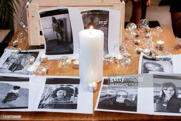Candles and portraits of people from the transgender community are pictured during a ceremony to support the transgender community and raise...